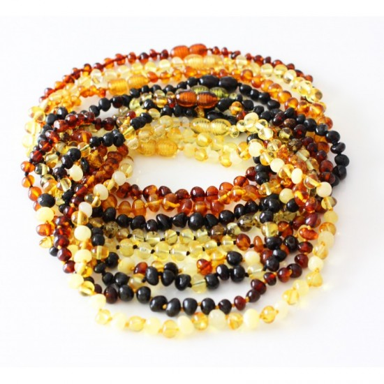 Lot of 10 baltic amber baby teething necklaces.