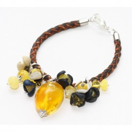 Unique baltic amber and natural leather charm bracelet.
